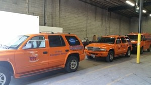 Water Damage Restoration SUV's At Warehouse