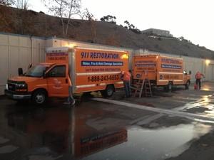 911 Restoration Trucks at Job Location