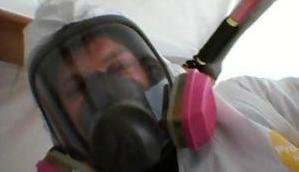 Mold Removal Technician With Gas Mask