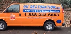 Water and Mold Damage Restoration Van At Fall Residential Job Site